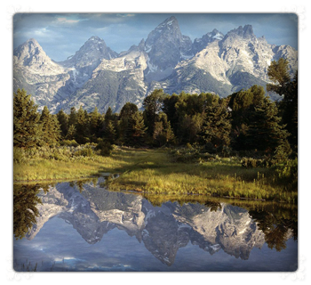 Image of the Tetons with a reflection of the Tetons in the lake